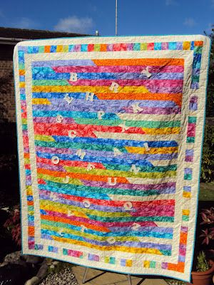 Jelly roll race (jelly roll 1600) quilt in rainbow colors with a great pieced border