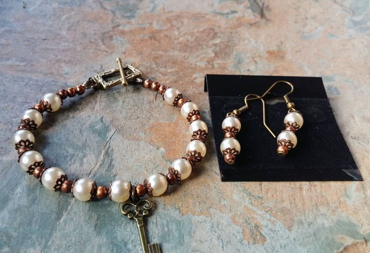 Pearl with copper and bronze detail and a key charm, handmade bracelet  and earring set, by SpryHandcrafted on Etsy