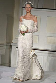 Brides: Dresses for Autumn Weddings. Silk radzimir and guipure lace gown ($12,750), guipure lace gloves ($1,490) and veil netting ($490), Oscar de la Renta.