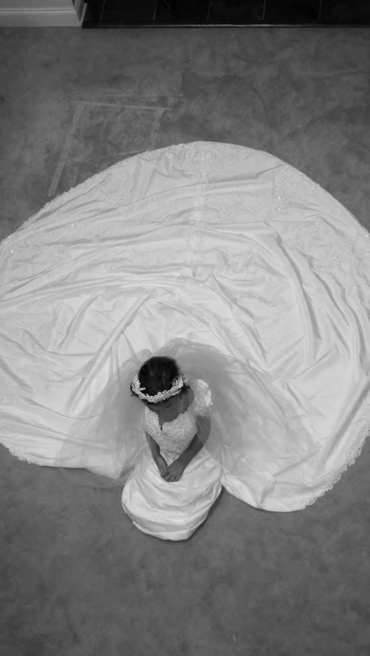 My youngest daughter in MY wedding gown!  So much fun, and an incredible keepsake!  Just blow picture up and set on HER wedding table when HER day comes!