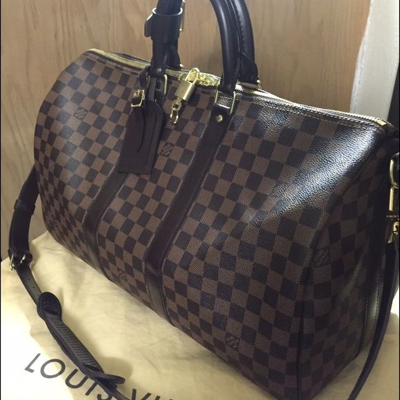Louis Vuitton Keepall 45 Bandouliere Damier Ebene Gently used, in great condition. Comes with original receipt, all the accessories, and I'll throw in a small box and dust bag for the luggage tag. Thanks for your interest! Will take offers. Louis Vuitton Bags Travel Bags