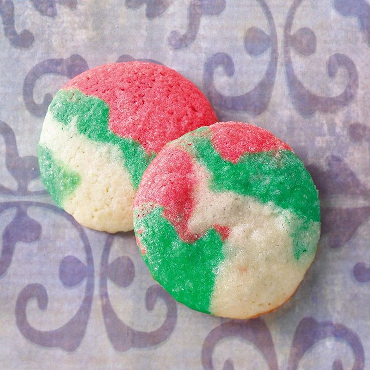 Swirled Mint Cookies Recipe -No one will believe that these rich and buttery cookies from Lois Hill of Thomasville, North Carolina are 'light,' but they are! And with their colorful swirls, each one of these minty sugary bites is unique.
