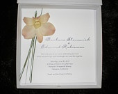 The Amanda Couture Boxed Wedding Invitation Package, now available from our spin-off company, Goosecreatures Design. This simple, striking design is embellished with a real orchid flower blossom and accented with a few blades of grass. The flower is preserved to maintain its shape and color. Invitation, reply card and matching envelope are tucked into our lovely white paper box with snap closure.