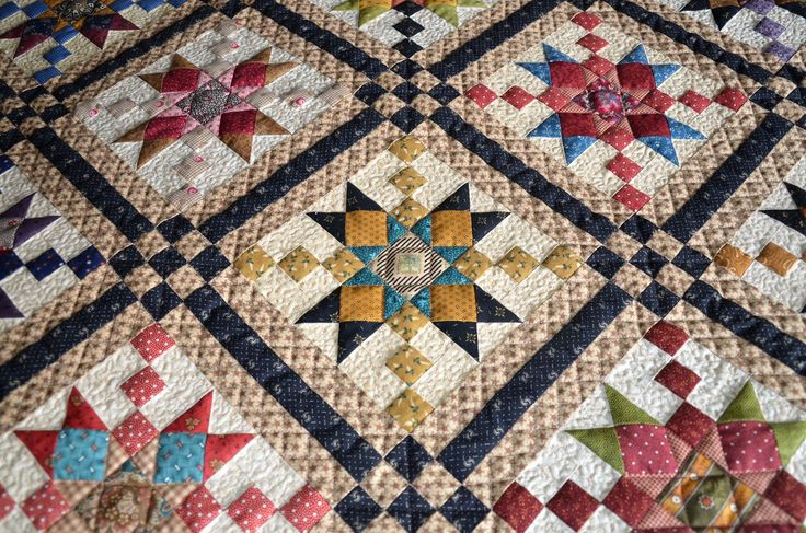 Sew'n Wild Oaks Quilting Blog: Country Charmer Quilt Along. Triple sashing with 9-patch cornerstones.