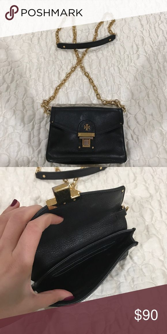 Tory Burch mini side purse. Tory Burch black mini side purse. Gold chain. Super classy and cute. Used but still gorgeous! Buckle is discolored very minimally. Tory Burch Bags Mini Bags