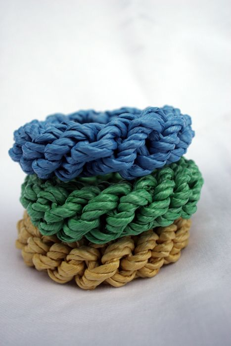 """These are dollar store DIY """"raffia"""" bangles and will run you about 50 cents a bangle, cheap enough to stack a dozen up your arm if you are so inclined or to make as gifts."""