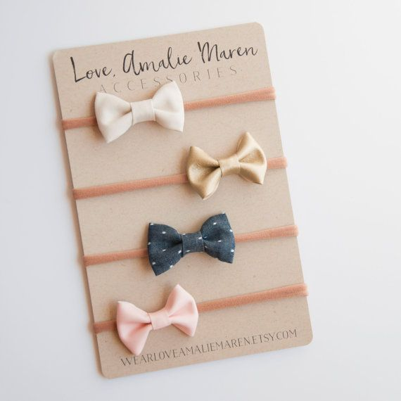 Tuxedo Bow Baby Headband Set of Four - Fabric Bows - Pink Gold Chambray Ivory - Baby Girl Infant Bow - Nylon Elastic or Toddler Hair Clip  This set includes (from top to bottom):  (1) Ivory (1) Gold (1) Denim Polka Dot (1) Blush Vegan Leather  Made to last with high quality cotton and the gentlest nylon elastic, these headbands are just as functional as they are adorable! These little tuxedo bows are the perfect accent of simple and chic, so when your little one steals the attention (...not…