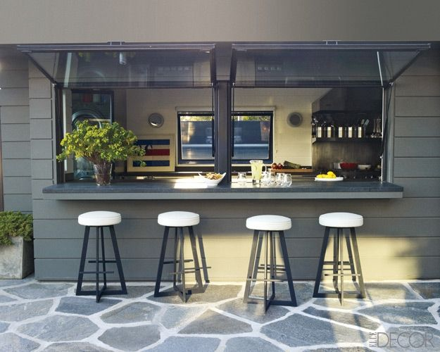 Servery from kitchen to Outdoor dining using hydrolic windows