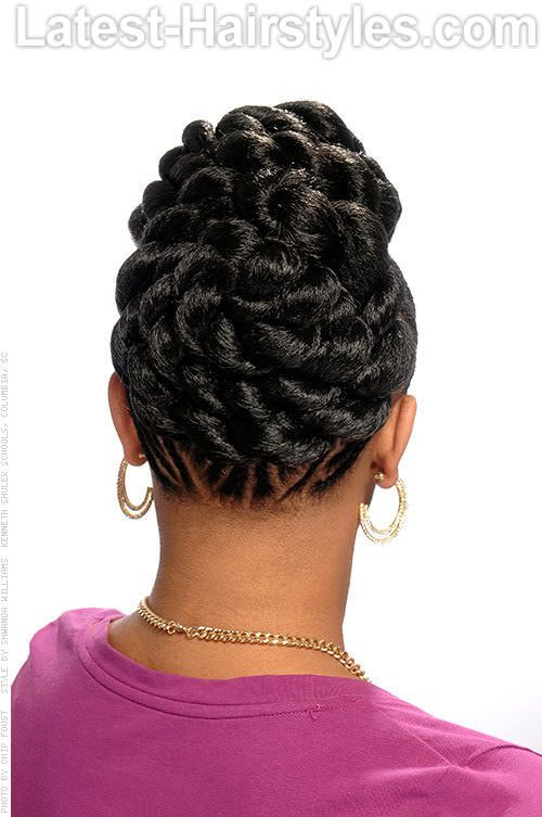 http://www.shorthaircutsforblackwomen.com/african-hair-braiding/ THE BRAIDED GODDESS - REAR VIEW. This style features a braided updo that has a lot of pizzazz and can be bring you from day to night with ease.