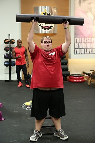 Jackson pushes his limits with a bar lift. #BiggestLoser