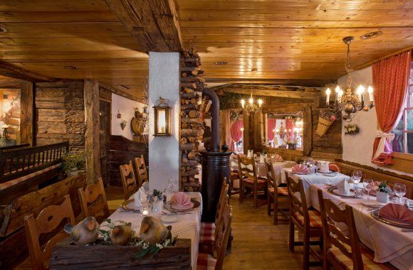 Restaurant La Ferme Saas Fee Dirndl-clad maidens bring traditional Valaisian specialities to the table at this barn-style restaurant, decked out with hops, cowbells and farming implements. Try tender lamb loin cooked in Alpine hay or fresh river trout.  Read more: http://www.lonelyplanet.com/switzerland/saas-fee/restaurants/other/la-ferme#ixzz3JYEf7V14