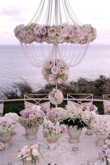 Elegant Vintage tablescape with abundant roses    love the chandelier effect.