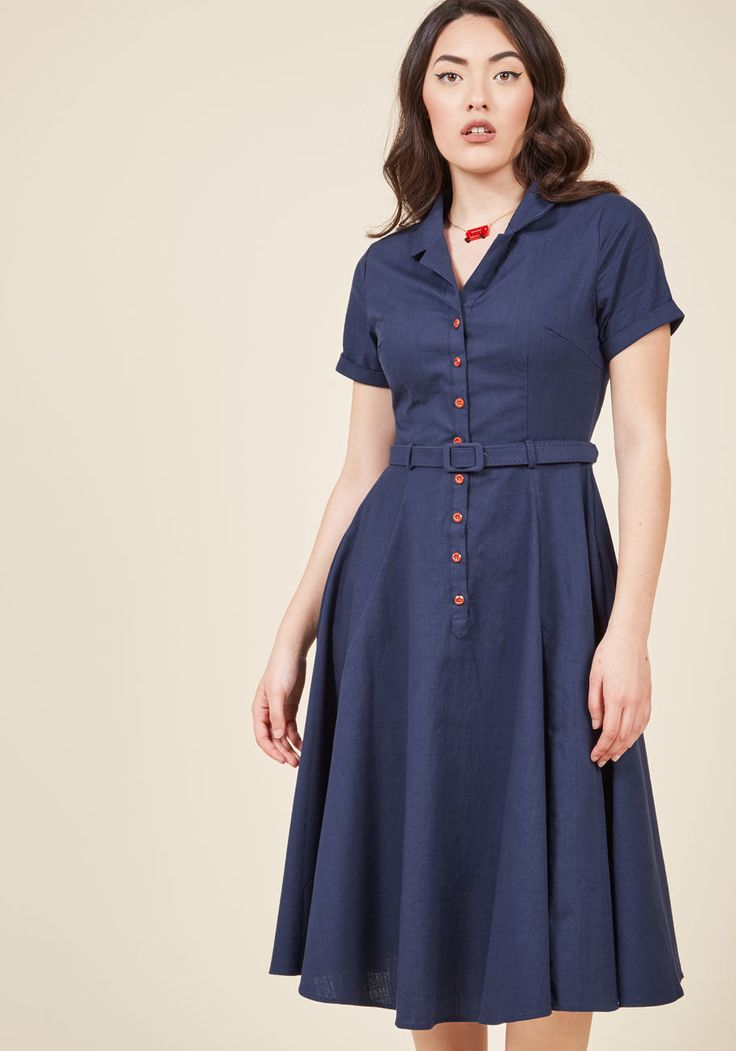 <p>Ahh, the fashionable finesse of bygone times! You embody just what made those decades special while decked out in this navy blue shirt dress - an incredible offering from collar to circle skirt! Cuffed sleeves, red buttons, a self belt, and pockets contribute both to the retro vibe of this stunning number, and to your deep love of throwback style.</p>