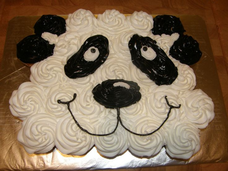 "Panda Cupcake - The mascot for elementary school where I work is Pandas. Created this ""Panda Cake"" for a class party. The cupcakes make it much easier to serve a class of 5 year olds."
