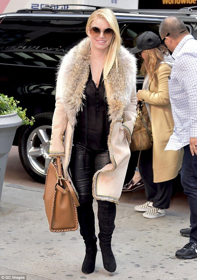 Eye-catching: Jessica Simpson bundled up in a fur-lined coat as she stepped out in New Yor...