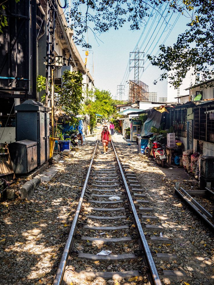 https://flic.kr/p/242Zrd8 | Railroad walk | This railroad in Bangkok is used for more purposes than just guiding trains.  This photo was taken using a Panasonic Lumix 20mm f/1.7 pancake lens and Olympus OM-D E-M10 camera.    See where this photo was taken.