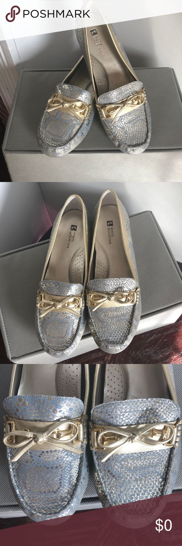 White Mountain Size 9 Gold & Blue Loafer Flats White Mountain size 9 snake print loafers in gold and a gorgeous baby blue / pewter color!  Very minimal wear on inside these flats (just from a pesky sticker that would not remove) soles show almost zero signs of wear.  Please feel free to ask any questions and offers are always welcome :) White Mountain Shoes Flats & Loafers