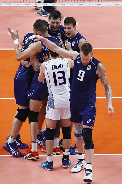 Italy celebrate a point over the United States during the Men's Volleyball…