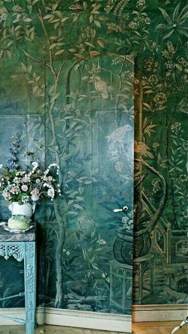 Hidden door. Beautiful wall! Tiles or mural over moldings?