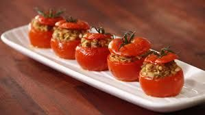 YEMISTA are tomatoes, peppers, courgette and aubergine stuffed with rice, herbs and raisins then oven baked.