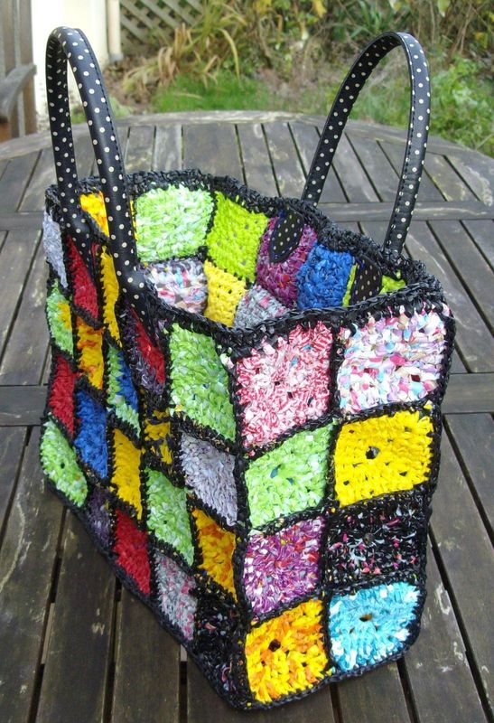 Apparently, this is made from recycled plastic bags! I have made things with plarn before - love the granny squares!