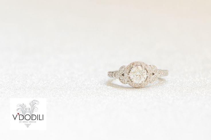 1.03ct, H, SI Round brilliant cut centre Diamond set in Platinum.