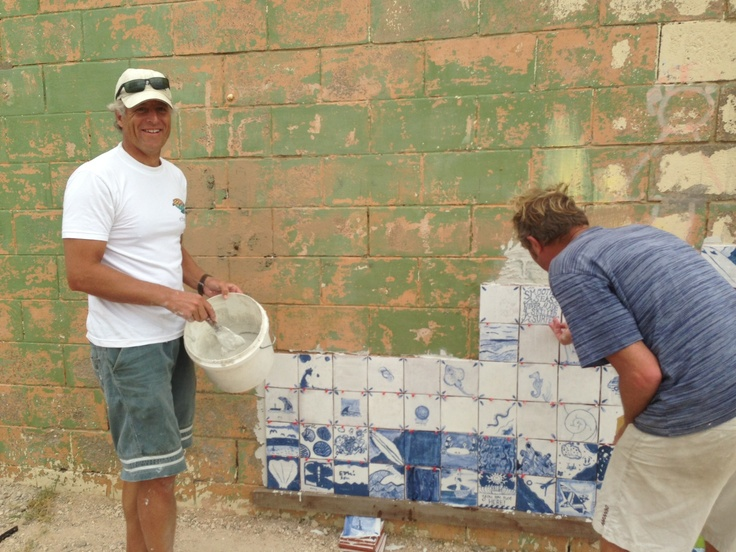 Hard at work on the reno of the Middleton Beach toilet blocks. Tiling with tiles handmade by local students! Great job!
