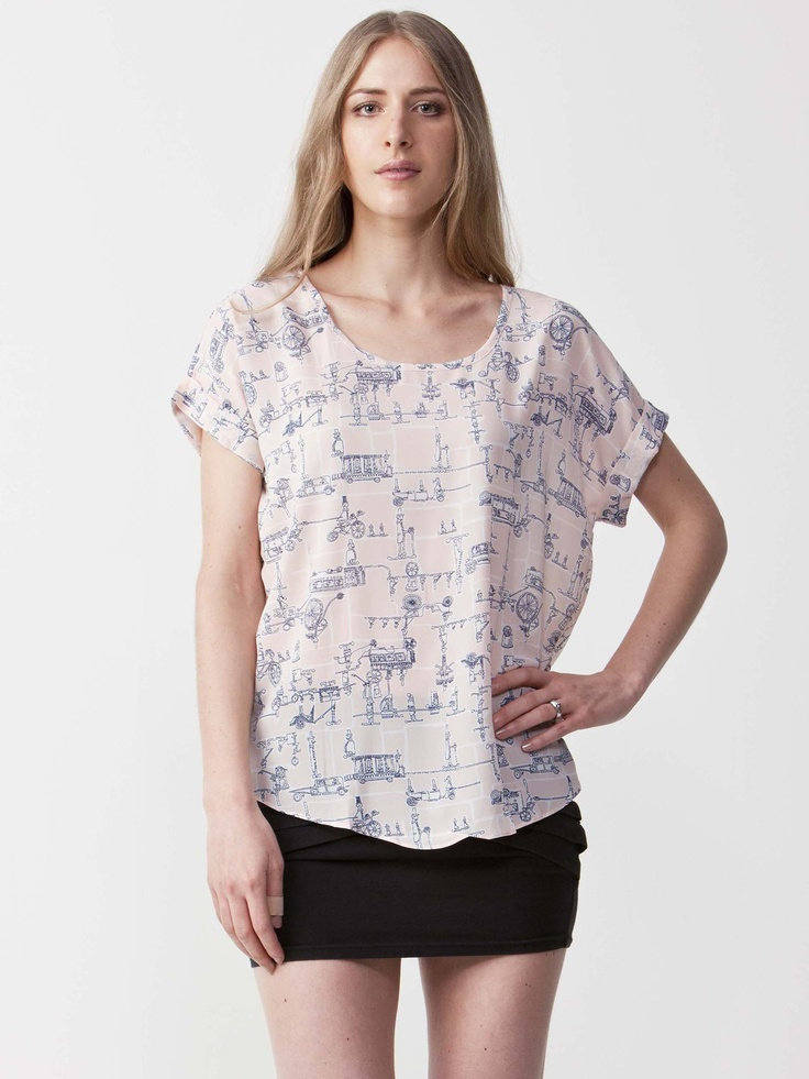 Tifa - Graphic Printed Top with round neckline. Folded short sleeve styling with loose fit. Regular cut and light graphic print. $44.00