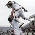 Tight end Andrew Gleichert lifts running back Nick Hill into the air after Hill scored in Michigan State's spring game. (AP Photo)