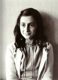 Remembering the Holocausts, remembering all the Holocausts with a picture of Anne Frank and with the advice that horrible things like these can still happen if we are not awake.
