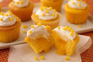 Prepare to be declared the winner of the next block-party bake-off! These moist and luscious cupcakes open to reveal a creamy mango filling.