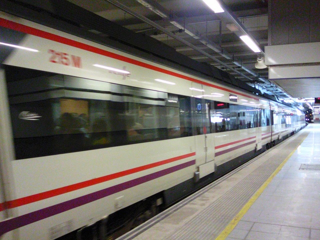 Train leaving Malaga Airport rail station in Spain: