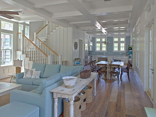 Compact Coastal Home with Turquoise Interiors Wooden Dining Table