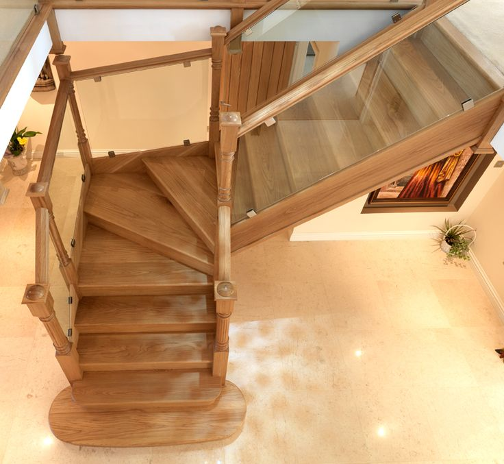 The Oak 115mm Corbridge newel post sets off the glass balustrading on this stylish oak kite winder staircase. The newel caps and 90mm newel posts were manufactured through our bespoke service to the customers specification.