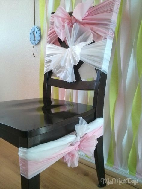 Dress up a chair using dollar store table cloths!  Baby Shower on a Budget!