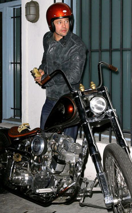 Brad Pitt getting on his motorcycle~