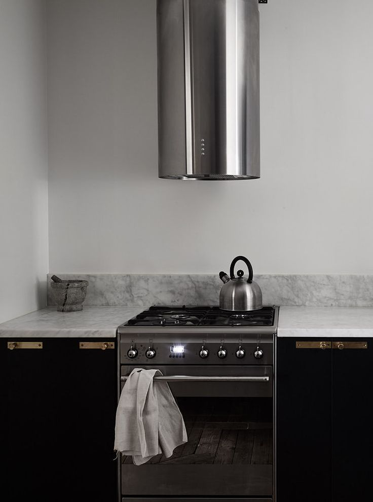 A beautiful home in dark colors - via Coco Lapine Design blog