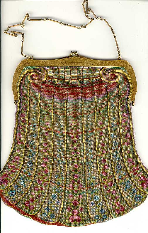 "Antique ""Tiffany gold purse"" made of thousands of tiny beads woven into an intricate Art Nouveau pattern. The clasp is mounted with 2 cabochon sapphires. The clasp and frame on this Tiffany beaded bag are 14K yellow gold and were undoubtedly hand chased by one of Tiffany's master engravers. The beadwork design echos the engraving design. Watered silk lining with mirror pocket."