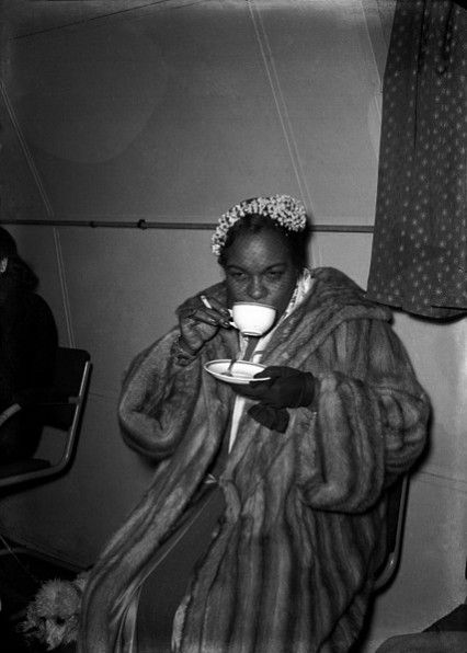 Winifred having a cup of tea and a cigarette before performing in 1952