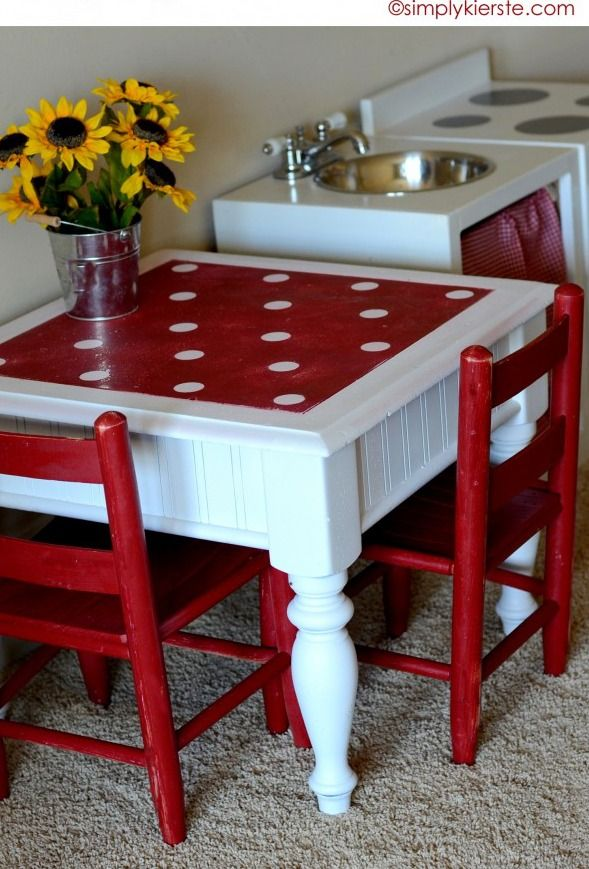 This polka-dot stenciled and spray-painted end table works perfectly as a child-sized play table!