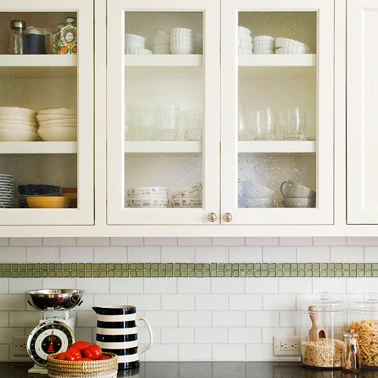 Clear View...Glass-front cabinets are a surefire way to open up a small kitchen. Leaded-glass inserts in these cabinets not only help the kitchen feel larger, but they also add a splash of vintage flair.