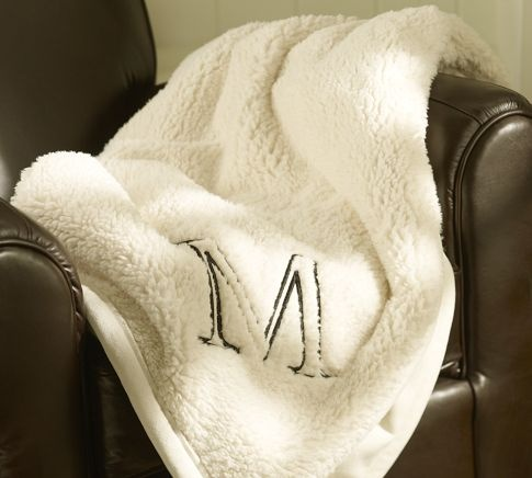 "faux sheepskin blanket from potterybarn...felt this in the store the other day and fell in love. told my mother i want it for xmas. went on the website and saw it monogrammed with an ""M"" and now I know i'm meant to have it :)"
