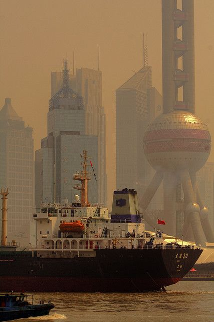Shanghai. An amazing place to live and visit.  I like this pic because this is what the air is really like most of the time.  Those blue sky days are a rarity!