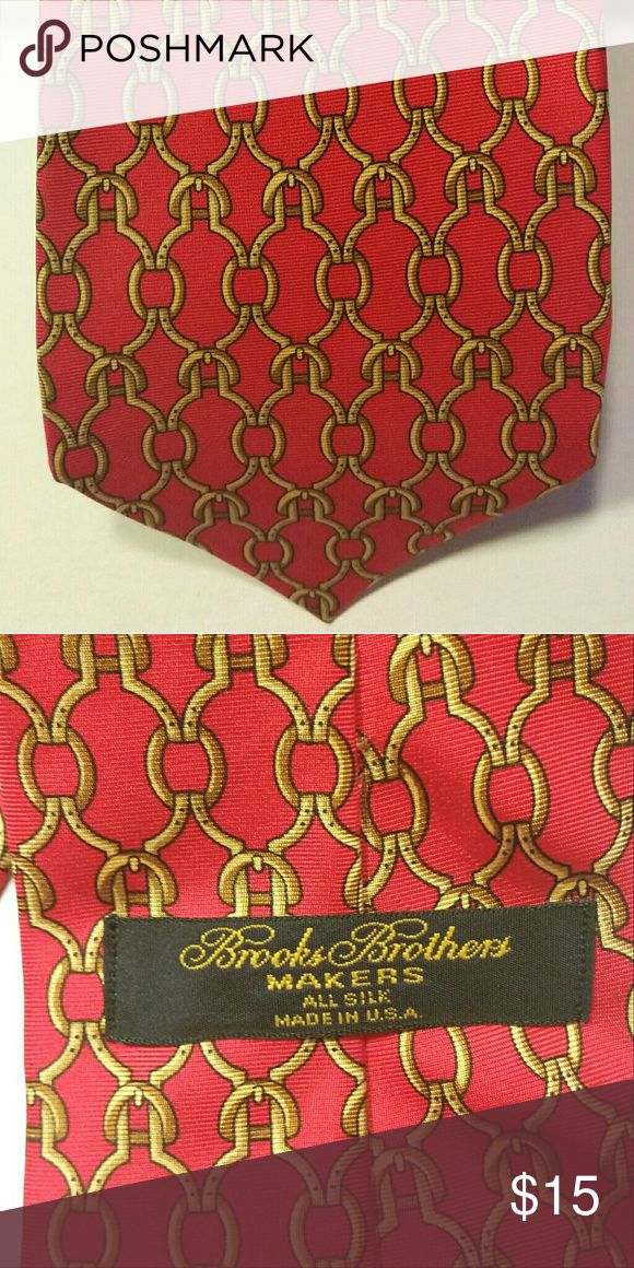 Brooks Brothers necktie, pure silk Brooks Brothers, pure silk necktie.  Red and gold (pattern has the Brooks Brothers horsebit incorporated into it).  Trying to whittle down husband's expansive tie collection.  Excellent condition! Brooks Brothers Accessories Ties