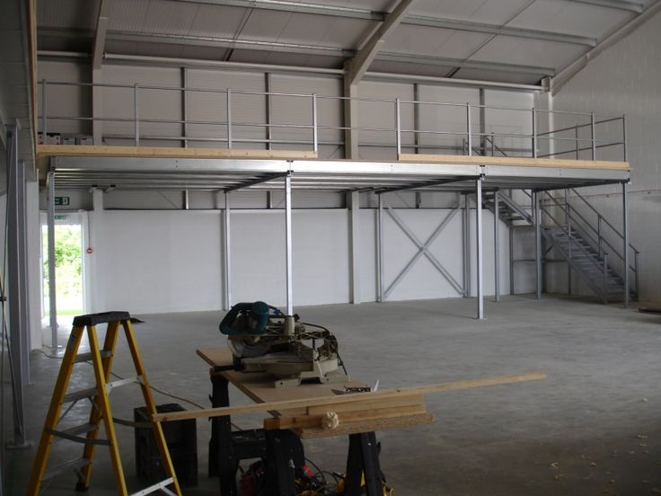 Mezzanine Floor and staircase designed and installed by The Raised Storage Area Co. & Associates #MezzanineFloor