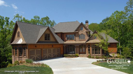 Craftsman house with cedar shingles and stone Craftsman