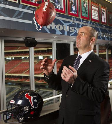 PENN STATE – FOOTBALL 2013 – Houston Texans head coach Bill O'Brien flips a football while taking a portrait after he was introduced at a news conference at Reliant Stadium on Friday, Jan. 3, 2014, in Houston. O'Brien comes to the Texas, replacing Gary Kubiak, after two seasons as the head coach at Penn State.