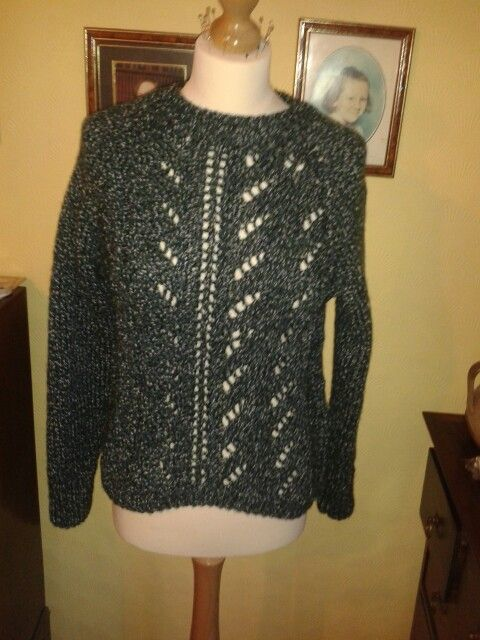Eyelet jumper by sirdar