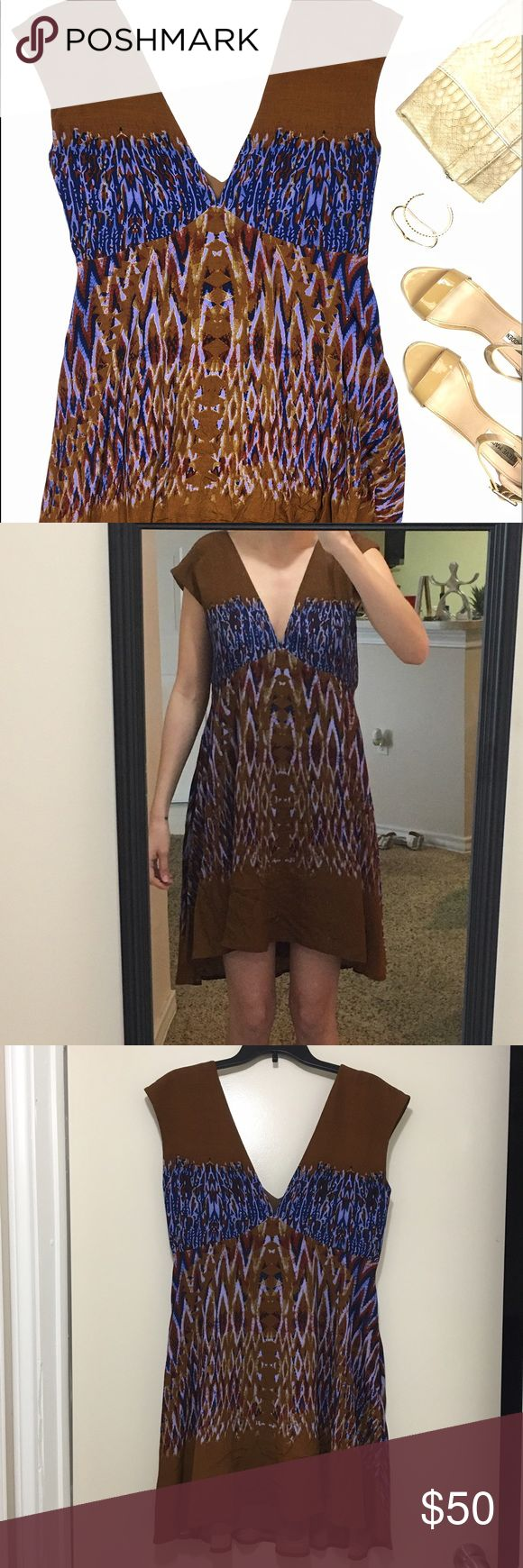Free People Brown & Blue Ikat Festival Print Dress Stunning dress which can be dressed up or down. Features a v-neck front and back and a hi-lo hem. Can also fit a Medium. Fully lined. 50% viscose, 50% rayon. Free People Dresses Mini