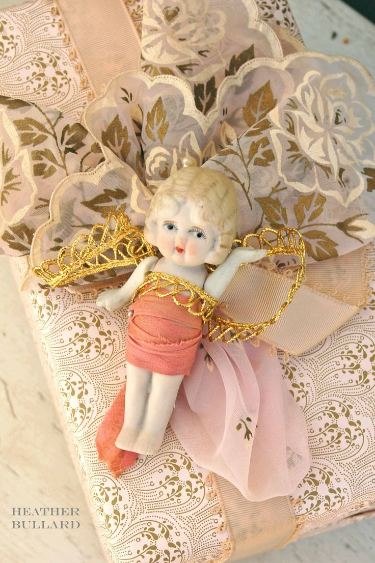 adorable bisque doll.....all wrapped up...precious!